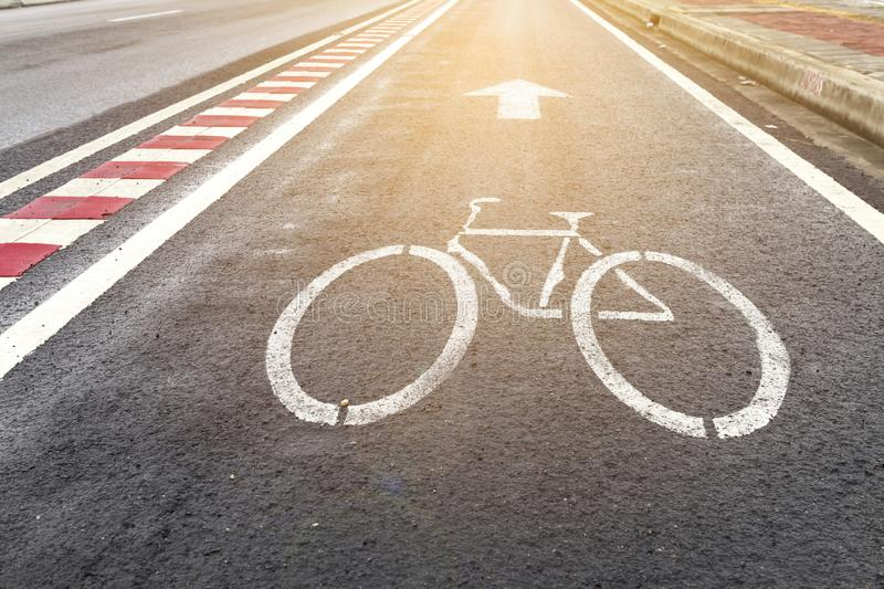 Bicycle way on the side of main road with vintage warm light. Traffic symbol concept royalty free stock photo