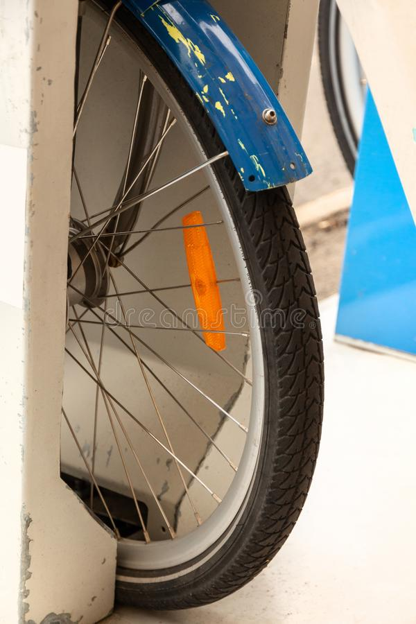 Bicycle wheel close-up in public parking bikes.  royalty free stock photography
