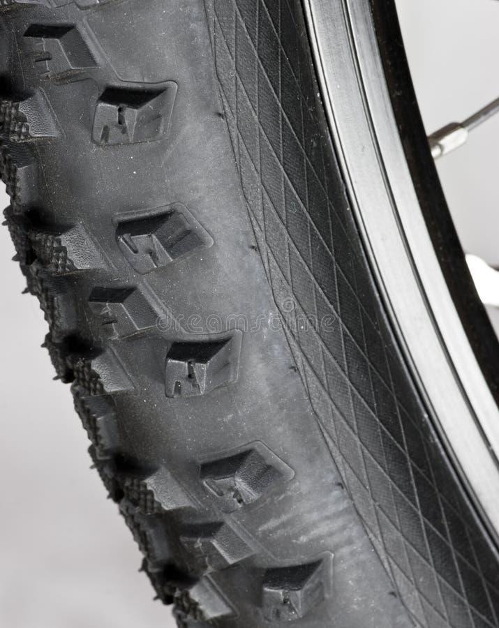 Bicycle wheel detail. Knobby mountain bike tire close-up stock photo