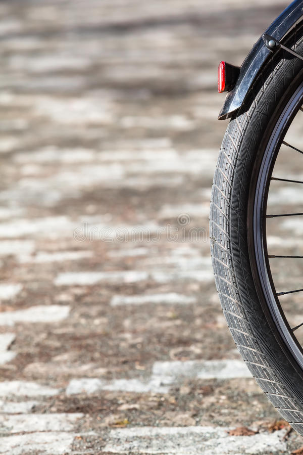 Bicycle Wheel Detail. Detail of black bicycle rear wheel with taillamp royalty free stock images