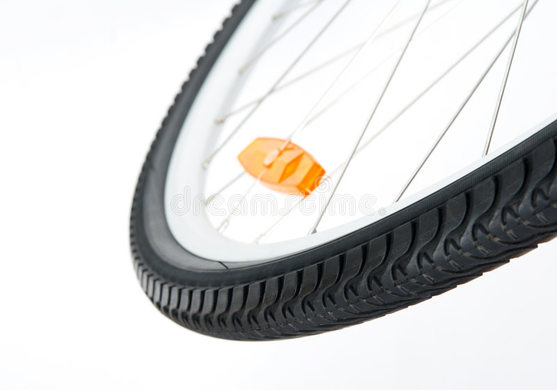 Bicycle wheel with orange reflector royalty free stock photography