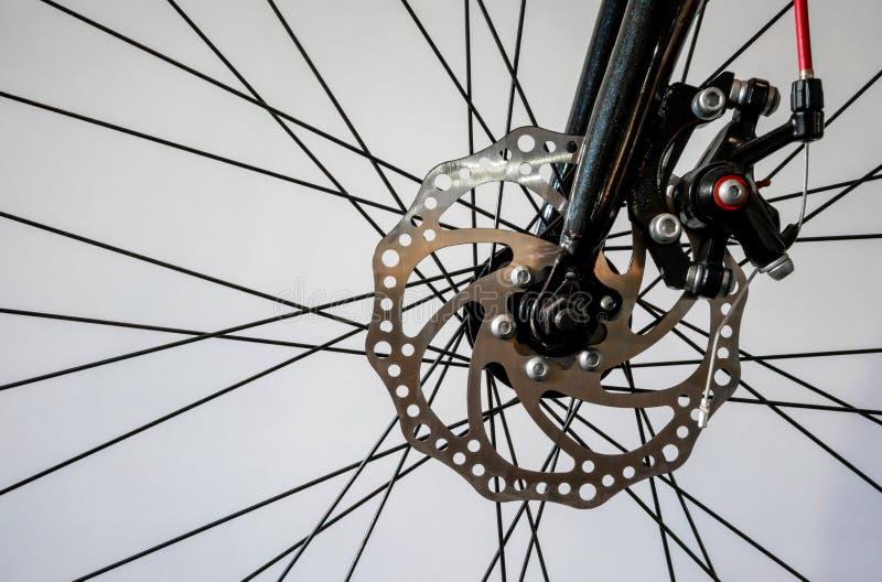 Bicycle wheel spoke detail isolated on white stock photos