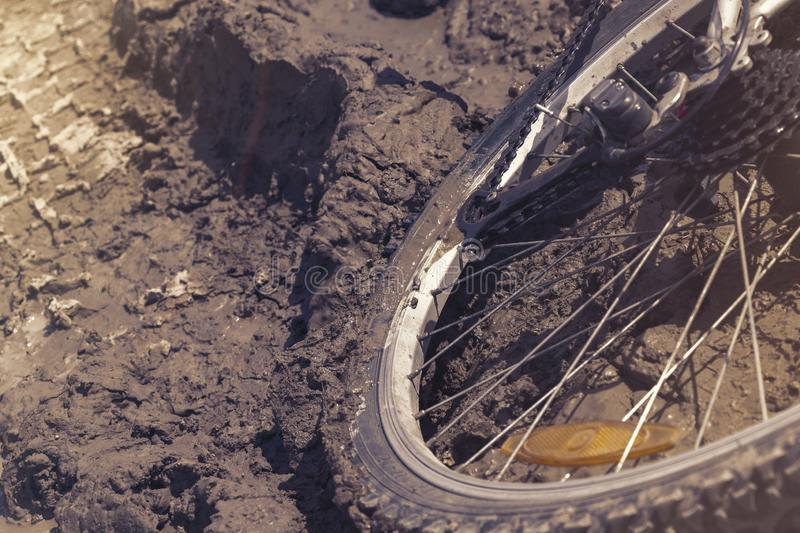 The Bicycle wheel is stuck in the mud. Close up royalty free stock image