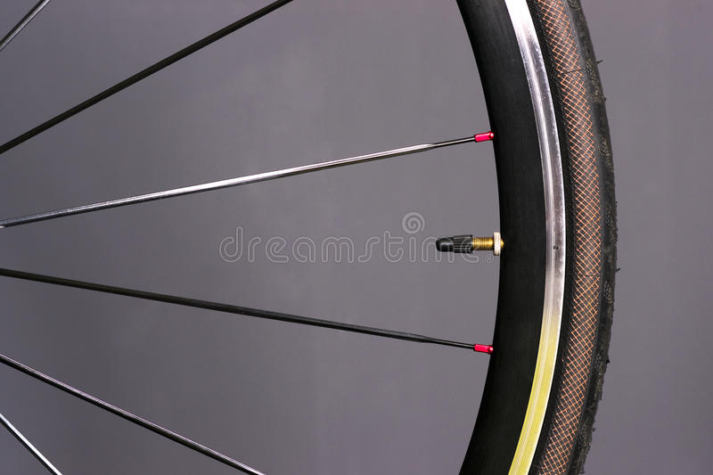 Bicycle Wheel Tire Mounted Bike Gear Spokes Metal Rubber. Portion of Front Bike Wheel Spokes Tire royalty free stock image