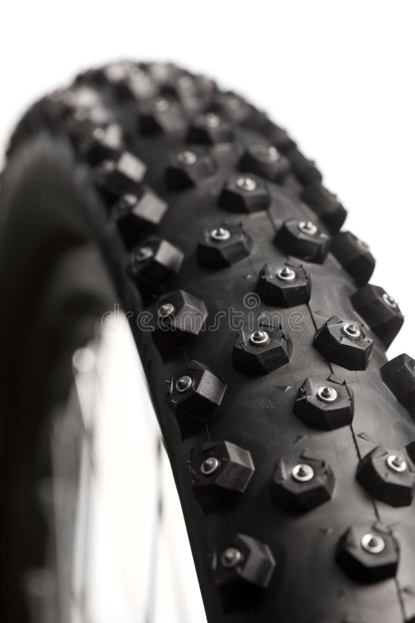 Bicycle wheel with winter tyre stock photography