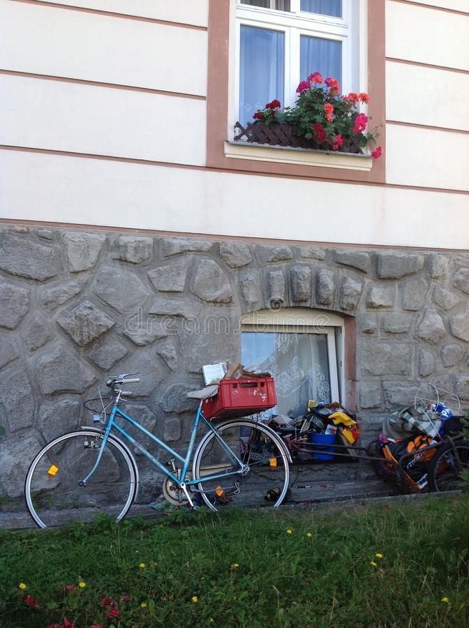 Bicycle and window with flowers stock image