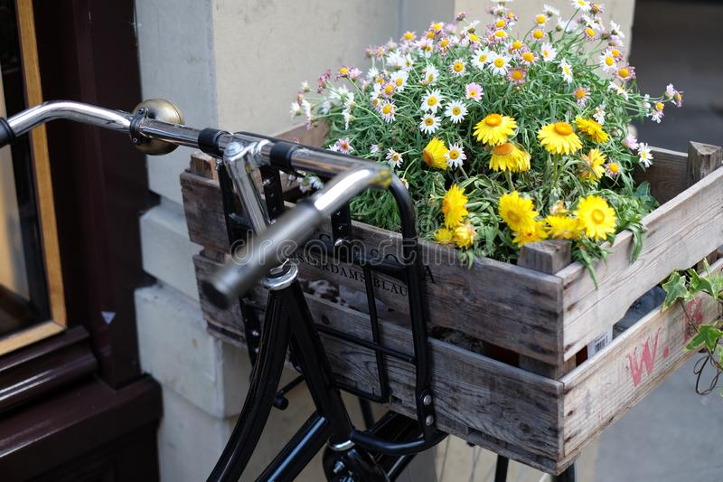 Bicycle with wooden crate carrying flowers stock image