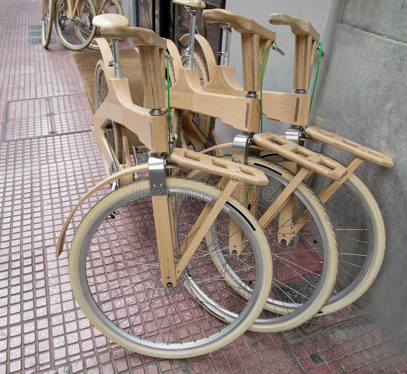 Bicycle wooden. Front wheel wooden bicycle near the grey wall stock images