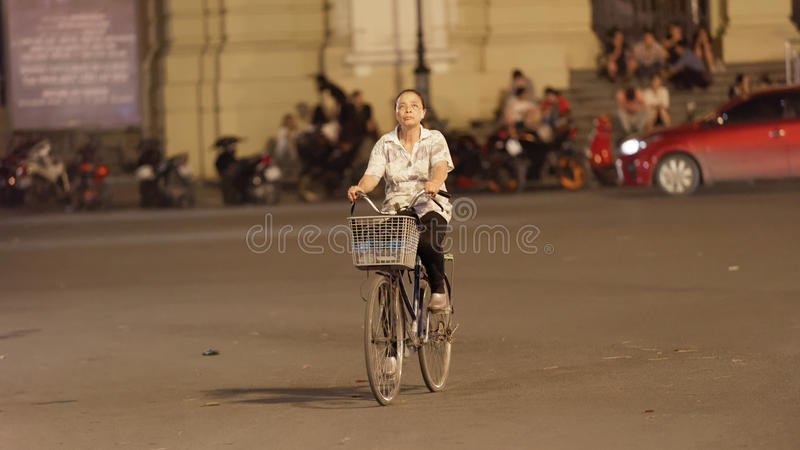 Bicycler on street in Old City of Hanoi stock photo