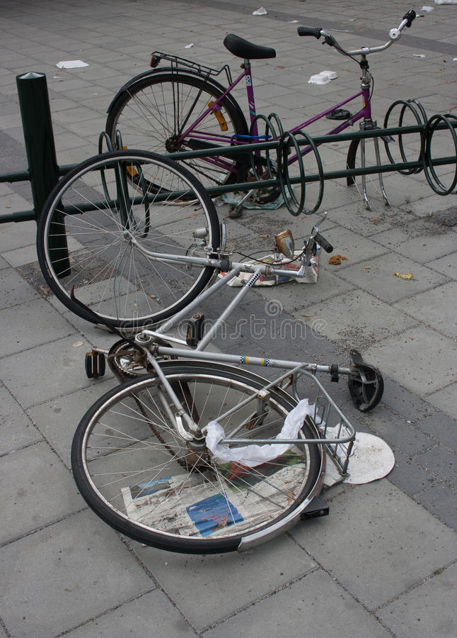 Bicycles abandoned on the sidewalk. Two bicycles abandoned on the sidewalk royalty free stock photo
