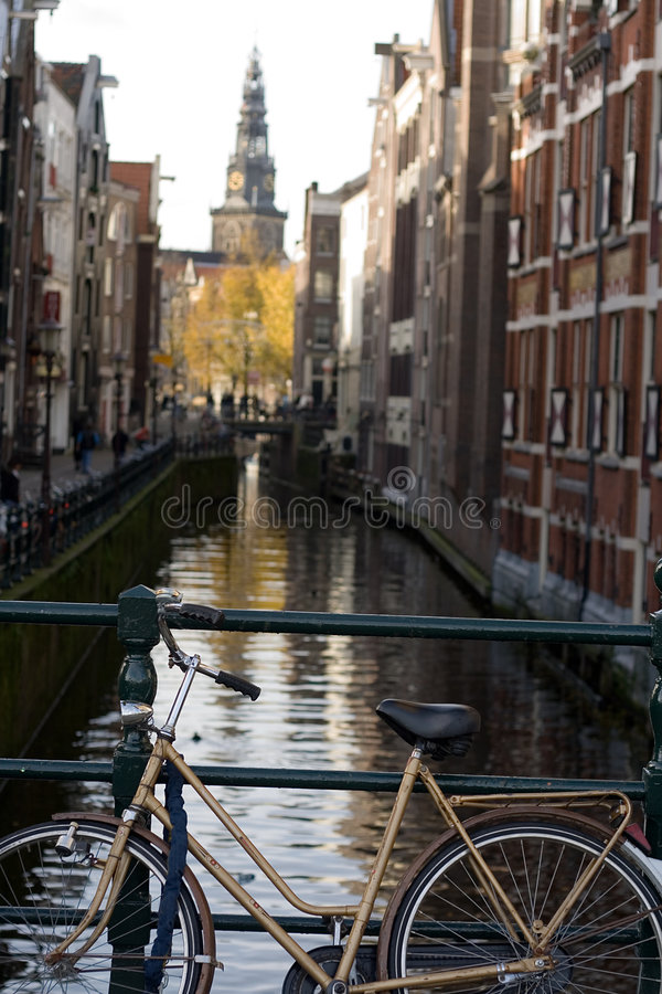 Bicycles along the Canals in A. Bicycles along and around the Canals in Amsterdam royalty free stock images