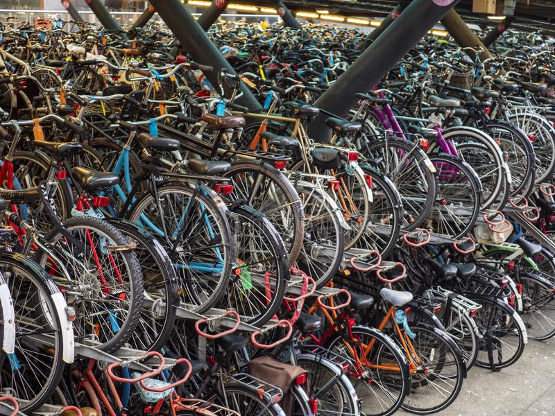 Bicycles in a bicycle park in Leiden, Netherlands. Closely packed bicycles in a bicycle park in the city of Leiden, the Netherlands stock image