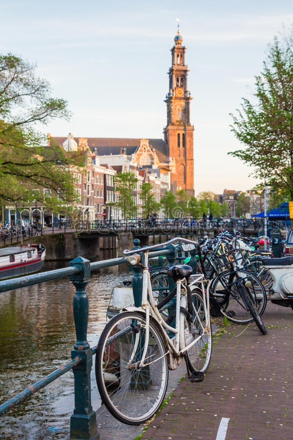 Bicycles and boats at streets of Amsterdam in autumn. Light royalty free stock photography