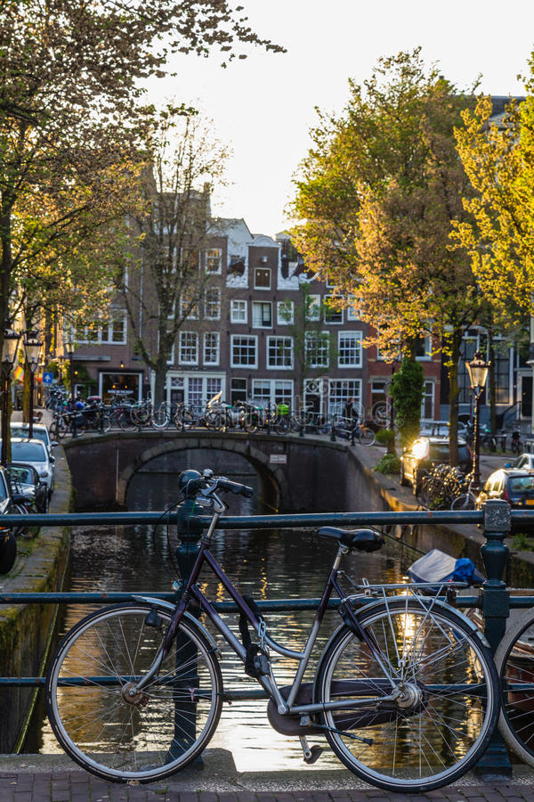 Bicycles and boats at streets of Amsterdam in autumn. Light stock image
