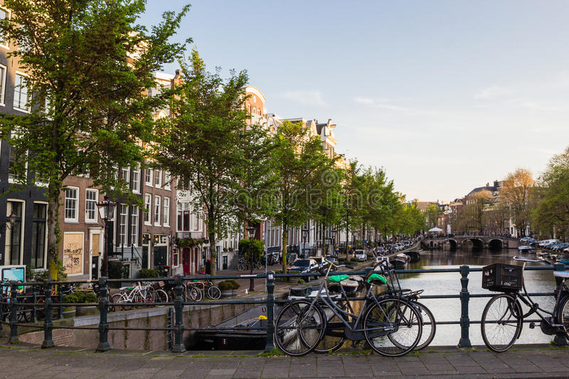 Bicycles and boats at streets of Amsterdam in autumn. Light stock images