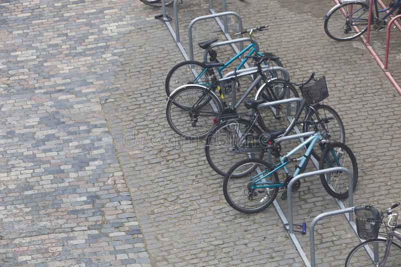 Bicycles chained up to railings royalty free stock images