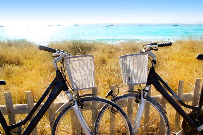 Bicycles couple parked in Formentera beach. Of Illetes royalty free stock photography