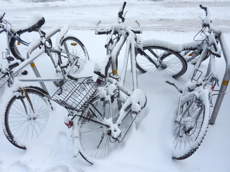 Bicycles covered by snow stock image