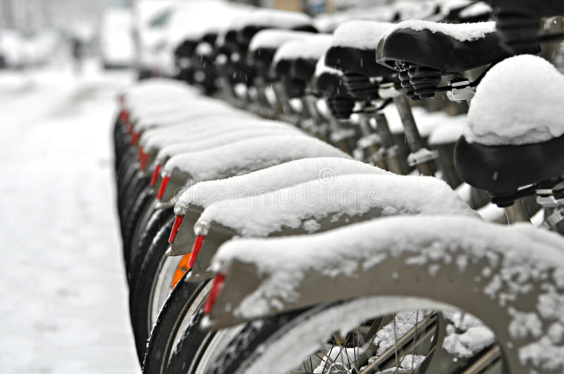 Bicycles covered in snow royalty free stock photo