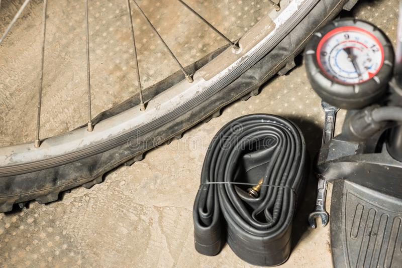 Mountain bike with punctured flat tire. Concept of bad luck and unforeseen. Bicycles with flat tire and equipment to replace it stock image