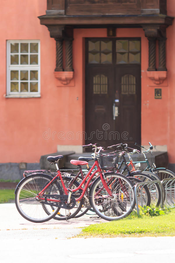 Bicycles in front of the door stock photos