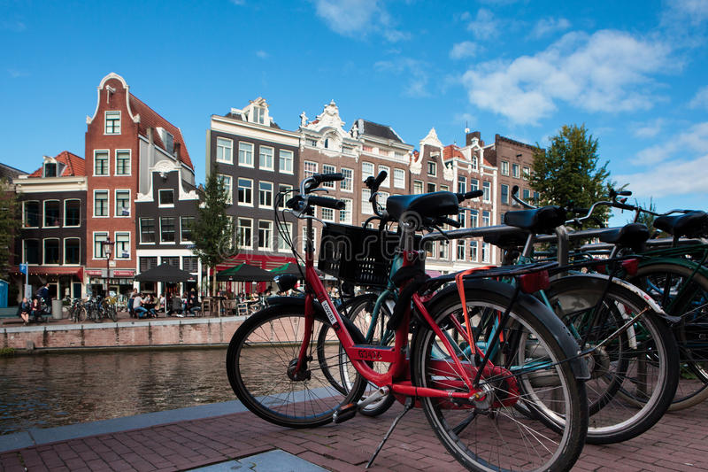Bicycles in front of Prinsengracht canal in Amsterdam, Netherlands. Amsterdam, Netherlands - October 3, 2016: Bicycles in front of Prinsengracht canal in stock photography