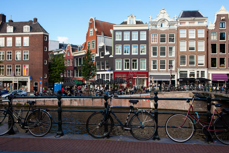 Bicycles in front of Prinsengracht canal in Amsterdam, Netherlands. Amsterdam, Netherlands - October 3, 2016: Bicycles in front of Prinsengracht canal in stock image