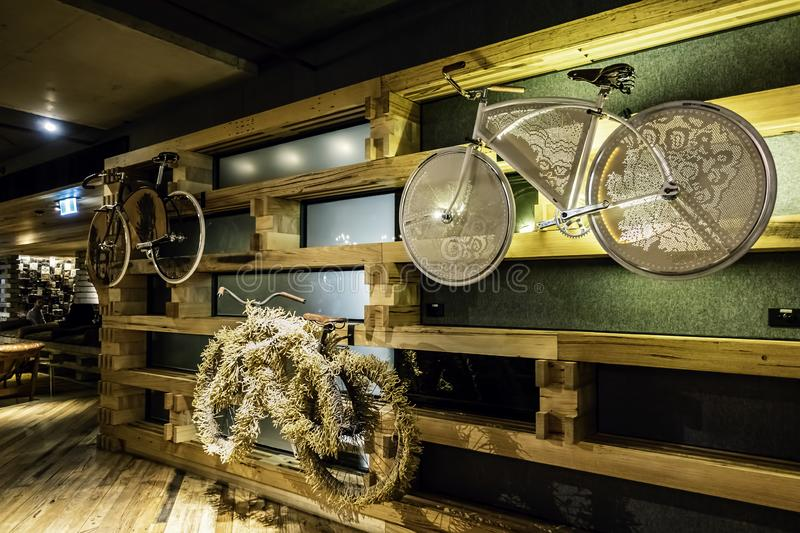 Bicycles hanging on the wall adjacent to the lobby of the Ovolo Nishi Hotel stock images