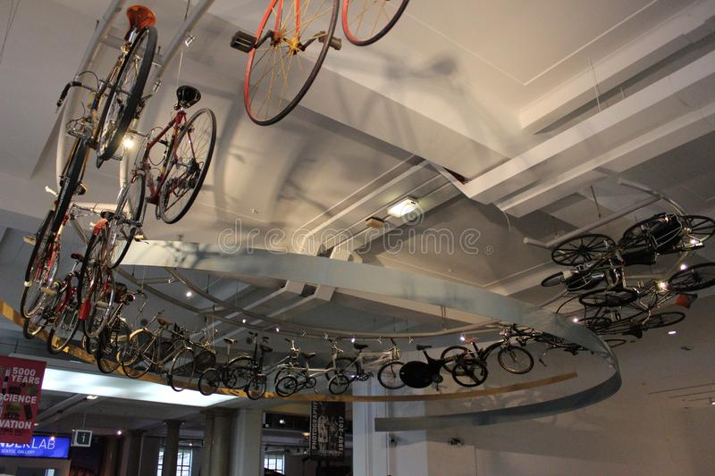 Bicycles mounted on the ceiling. A different bicycles mounted on the ceiling and created round way royalty free stock image