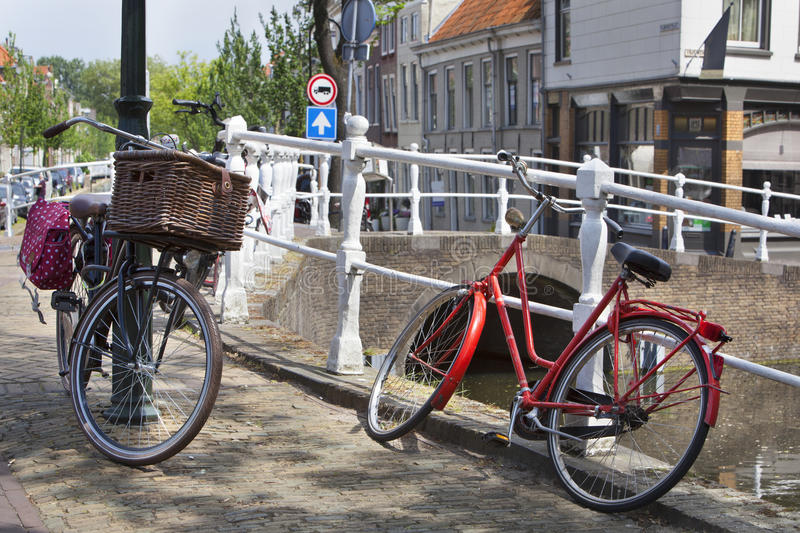 Bicycles near a canal in Delft stock images
