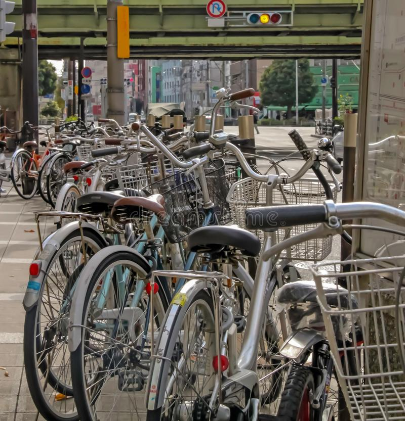 Bicycles parked along side of pathway. In Osaka royalty free stock images