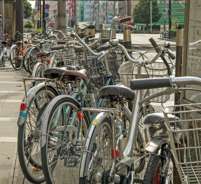 Bicycles parked along side of pathway. In Osaka royalty free stock image