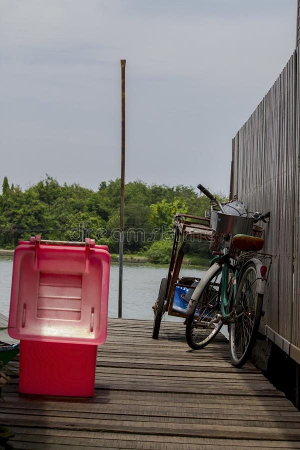Bicycles parked on bridge And lean on the fence. stock image