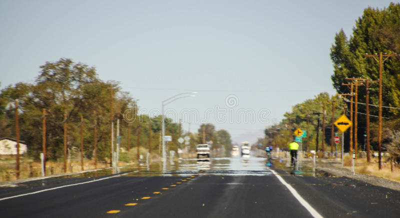 Bicycles ride into a mirage stock photography
