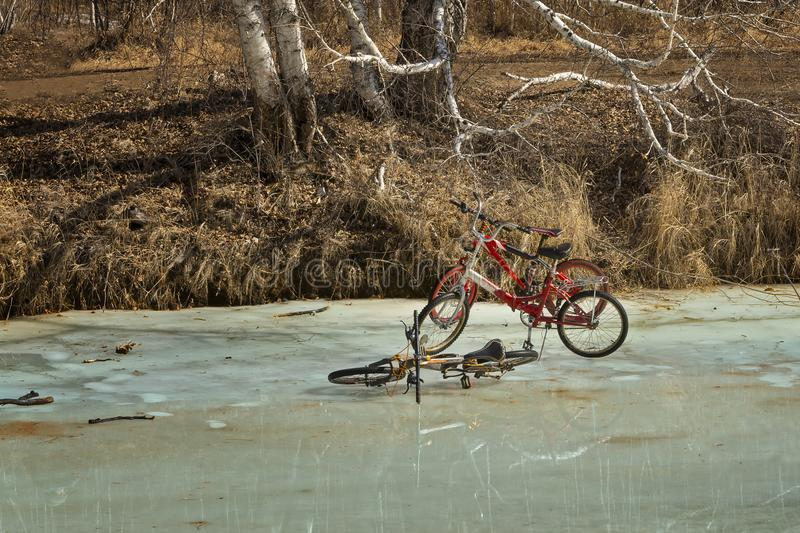 Three bikes on ice in the spring. Bicycles on the river in early spring, when the ice begins to melt royalty free stock photos