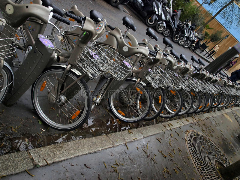Bicycles in a row, a public bike sharing system in Paris. With more than 20,000 bikes royalty free stock photo