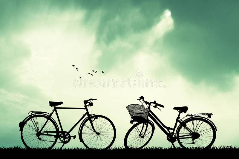 Bicycles at sunset. Illustration of bicycles at sunset stock illustration