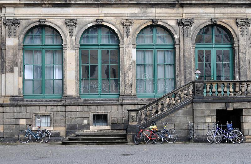 Bicycles at zwinger, dresden. Bicycles parked just outside of a wall of the famous baroque palace in dresden stock photo