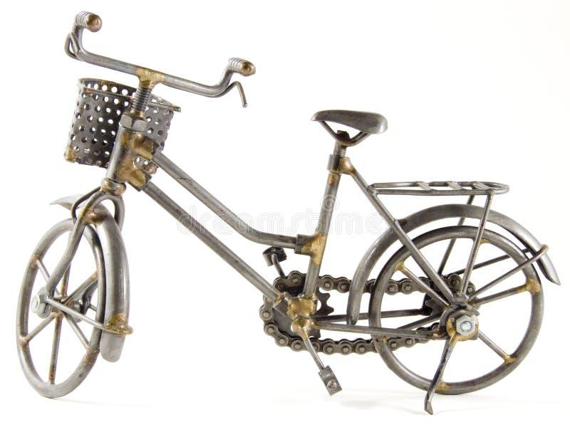 Bicyclette de jouet avec le chemin d'isolement photo libre de droits