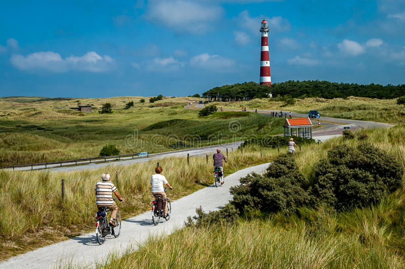 Bicycling in dunes royalty free stock photos
