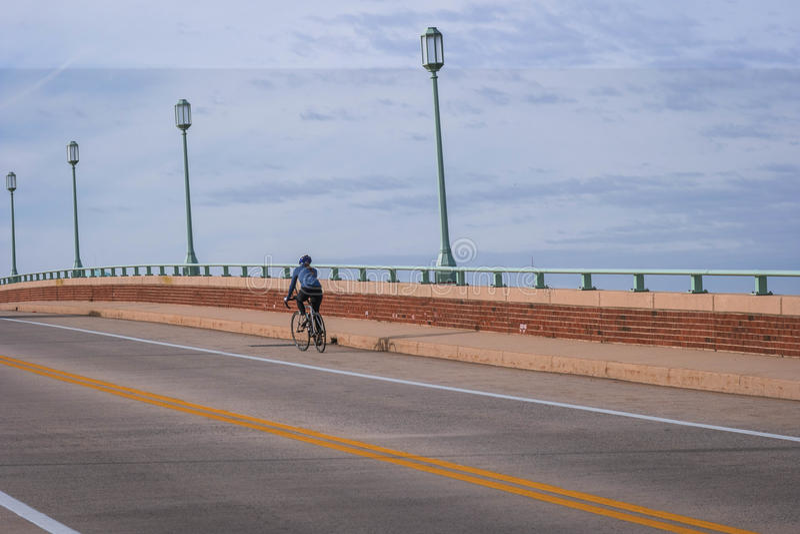 Bicyclist on a Bridge royalty free stock photos