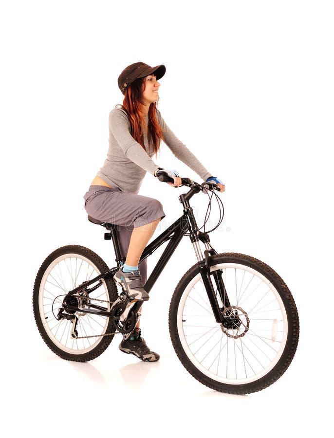 Bicyclist da mulher fotografia de stock