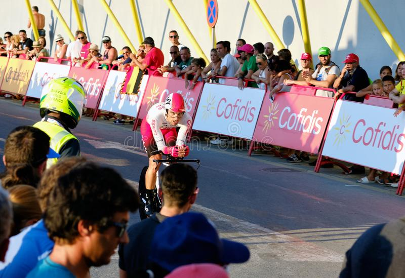 Bicyclist racers take part in La Vuelta competition. Torrevieja, Spain - August 24, 2019: Bicyclist racers take part on competition popular event of La Vuelta stock image