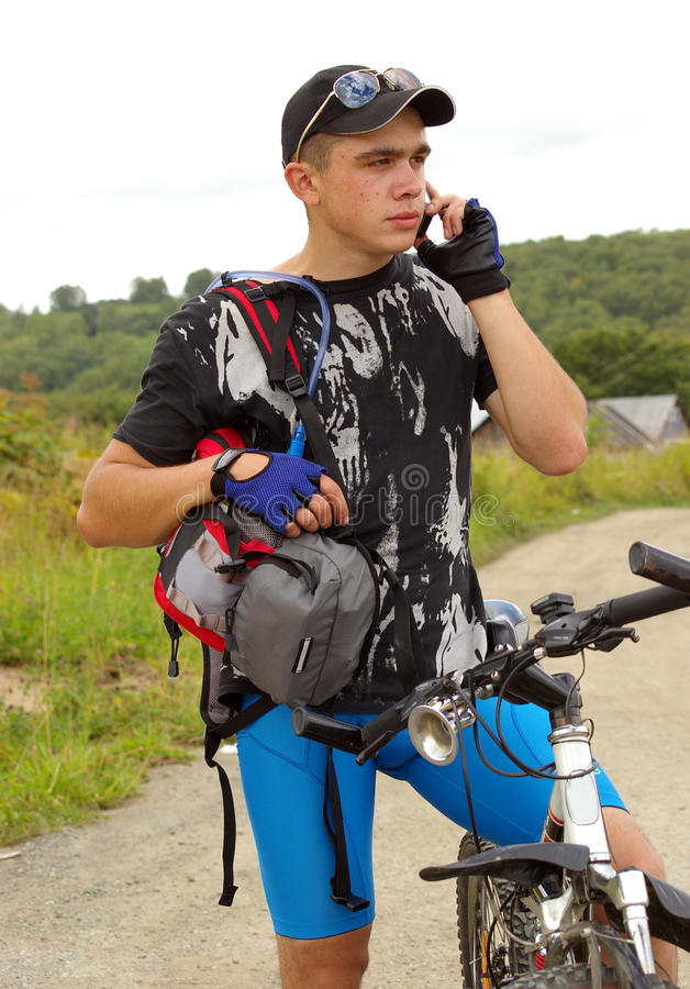 Bicyclist with telephone royalty free stock photos