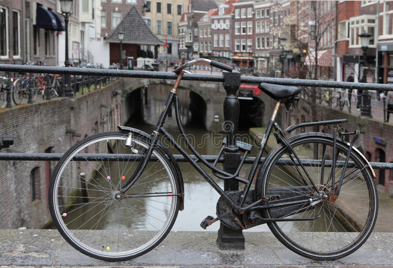 Bicykle, Utrecht. City cruiser bicycle, locked to the balustrade of the bridge, Utrecht Netherlands royalty free stock photography
