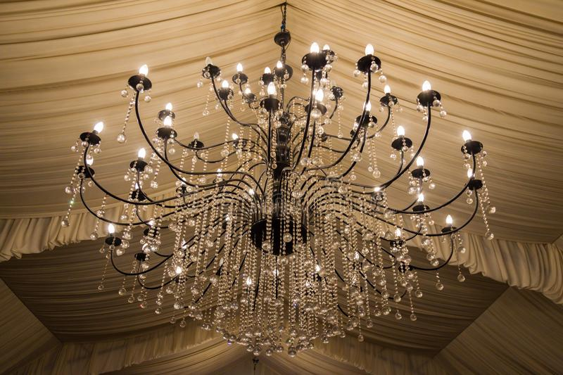 A bid chandelier in a weddings hall stock images