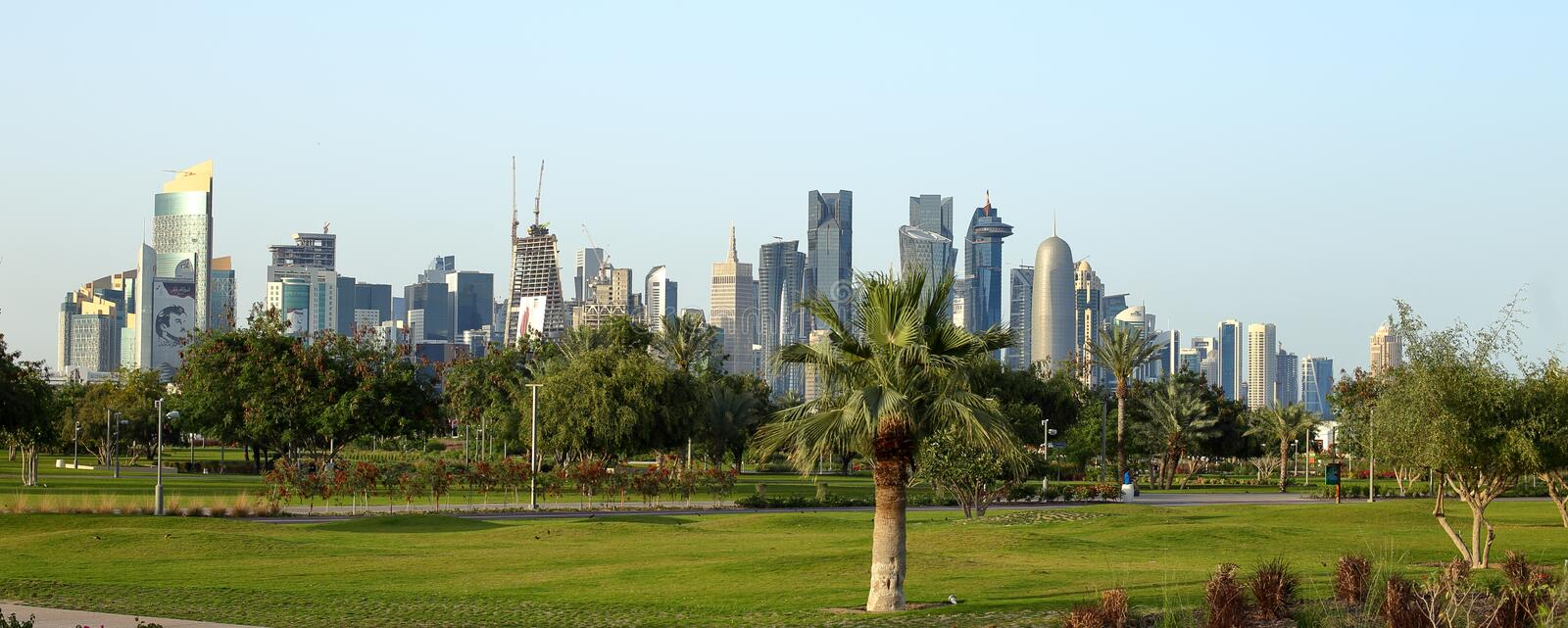 Towers seen from Bidda Park in Doha, Qatar. BIDDA PARK, Doha, Qatar - March 21, 2018: View of the newly opened Bidda Park in the centre of Qatar`s capital royalty free stock photo