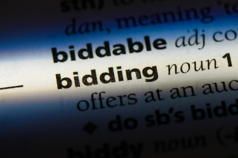Bidding. Word in a dictionary.  concept royalty free stock images