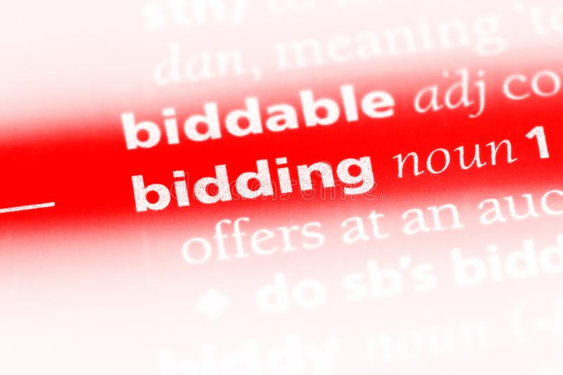 Bidding. Word in a dictionary.  concept royalty free stock photos
