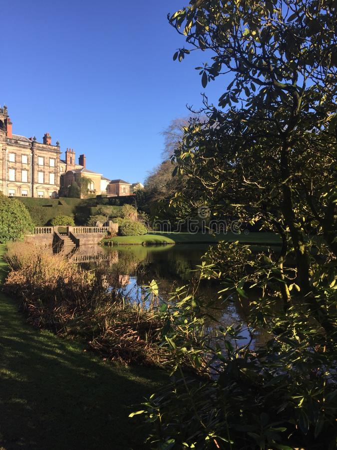 Biddulph Grange park in Staffordshire. View of the formal gardens with the lake, on a sunny winter day royalty free stock photos